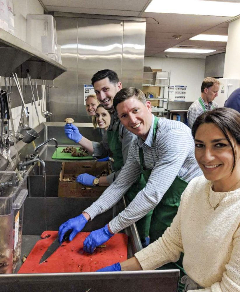Columbia Pacific Wealth Management Team helping cook meals for others